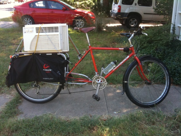 xtracycle hauling air conditioner window unit