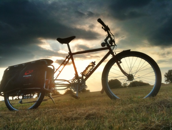 xtracycle against beautiful cloudy sky background