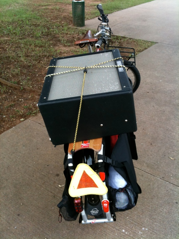 xtracycle carrying a heavy guitar amplifier