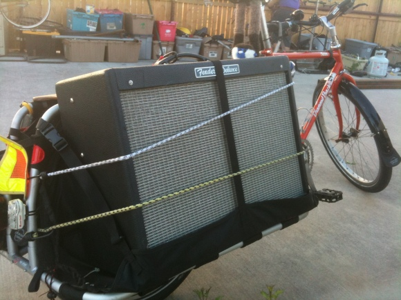 xtracycle carrying guitar amp on side