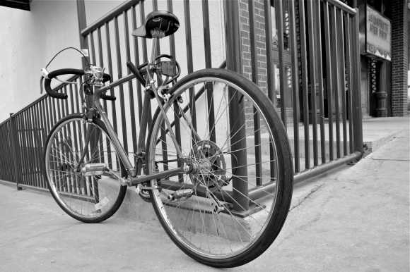 bike chained to handrail on the Denton square